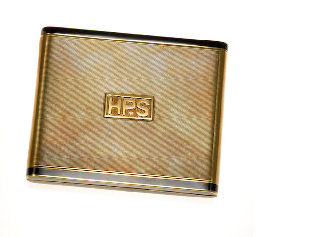 An enamel and fourteen karat gold cigarette case