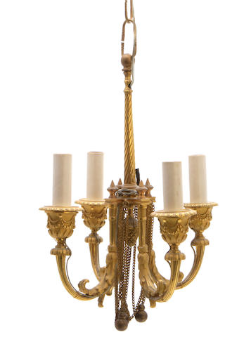 A diminutive Louis XVI style gilt bronze four light chandelier