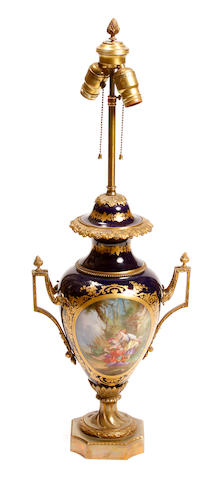 A Louis XV style gilt bronze mounted porcelain urn, now as a table lamp