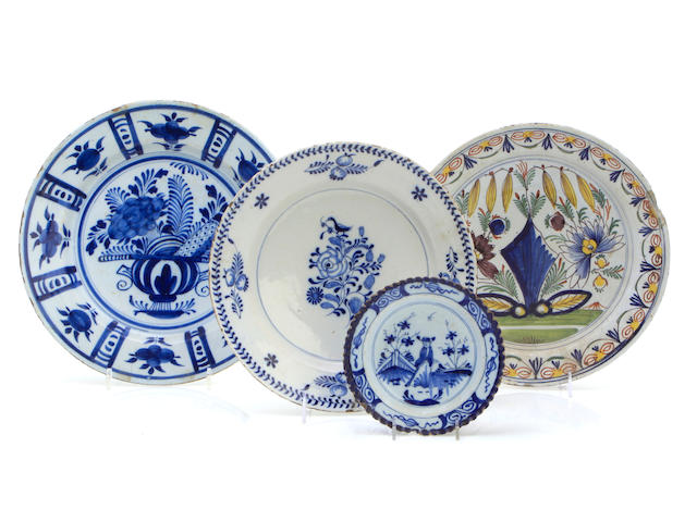 A group of four Dutch tin glaze plates