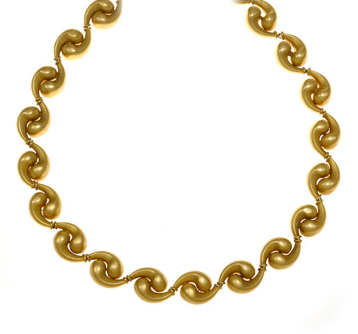 An eighteen karat gold fancy link necklace