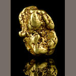 A gold nugget with limonite 6.295ozt (195.8g, 125.9 dwt)