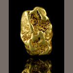 A gold nugget with limonite 4.765ozt (148.3g, 95.3 dwt)
