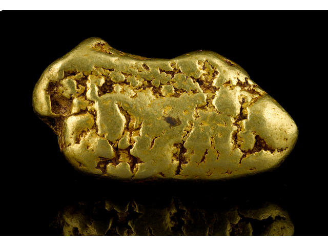 A gold nugget 18.77ozt (583.9g, 375.4 dwt)