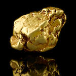 A gold nugget with quartz 12.73ozt (395.9g, 254.6 dwt)