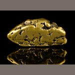 A gold nugget 14.94ozt (464.7g, 298.8 dwt) height 3in; width 1 3/4in; depth 1 1/4in
