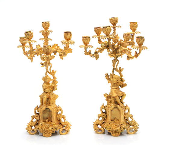 A pair of Louis XV style gilt bronze seven light candelabra