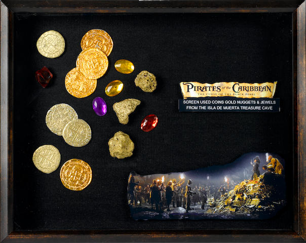 "A group of 'gold' coins, nuggets and jewels from ""Pirates of the Caribbean – The Curse of the Black Pearl"""