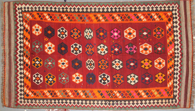A Kilim size approximately 4 ft. 9in. x 9ft. 5in.