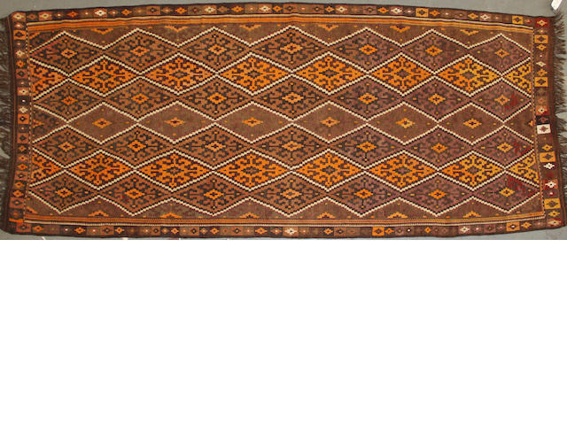 An Afghan kilim size approximately5ft. 3in. x 13ft. 3in.