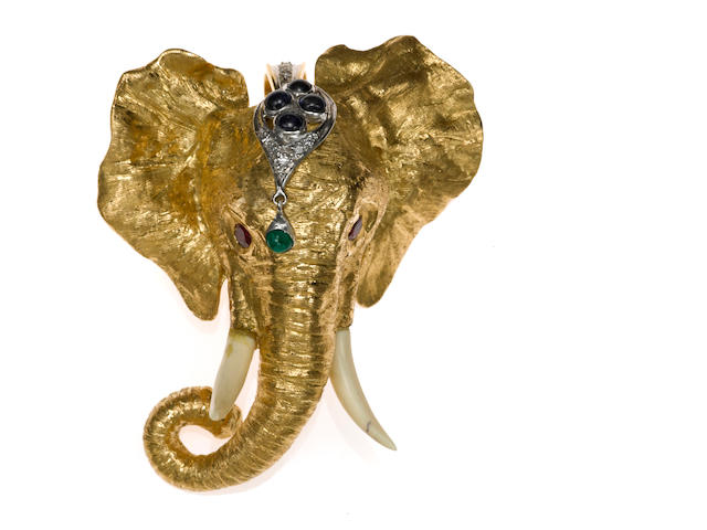 Gold, diamond and gemset elephant head pendant