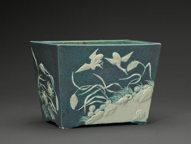 A molded robin's egg blue square sided jardiniere six character raised Qianlong mark, Republic Period Decorated with geese in flight over landscape and sea life, millet