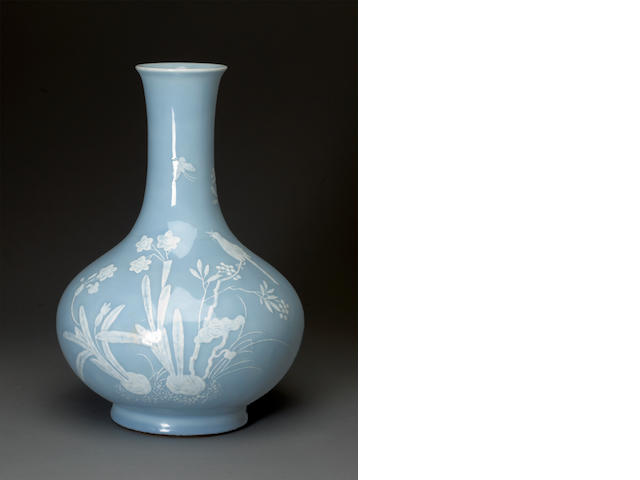 A blue glazed ovoid vase with raised white slip  decoration Qianlong   (drilled)