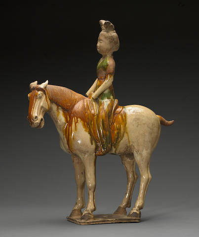 A sancai glazed pottery figure of a female equestrian probably Tang dynasty