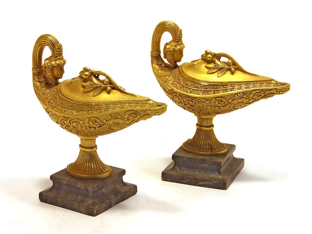 A pair of Empire style gilt bronze navette form brûle parfume on marble plinths 20th century