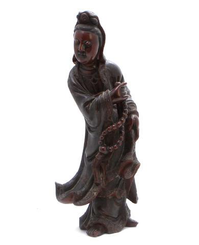 A laquered wood figure of Guanyin