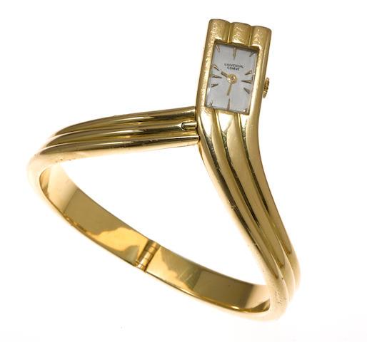 An eighteen karat gold bangle bracelet wristwatch, Universal Geneve