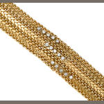 A diamond and fourteen karat gold covered dial integral bracelet wrist watch