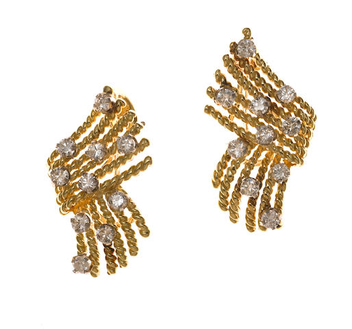 A pair of diamond and gold earclips, Schlumberger