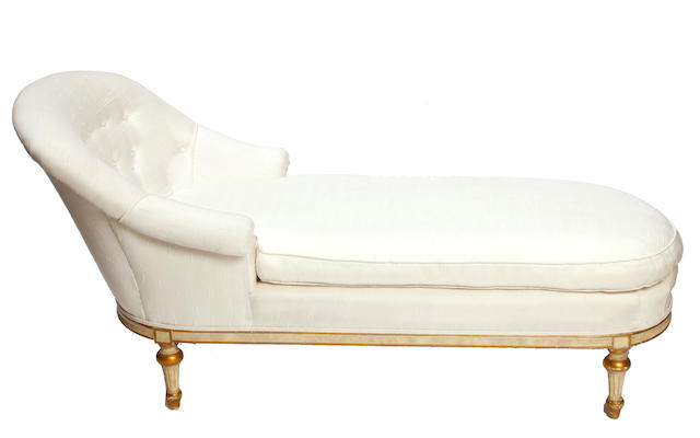 A Louis XVI style paint decorated parcel gilt chaise lounge