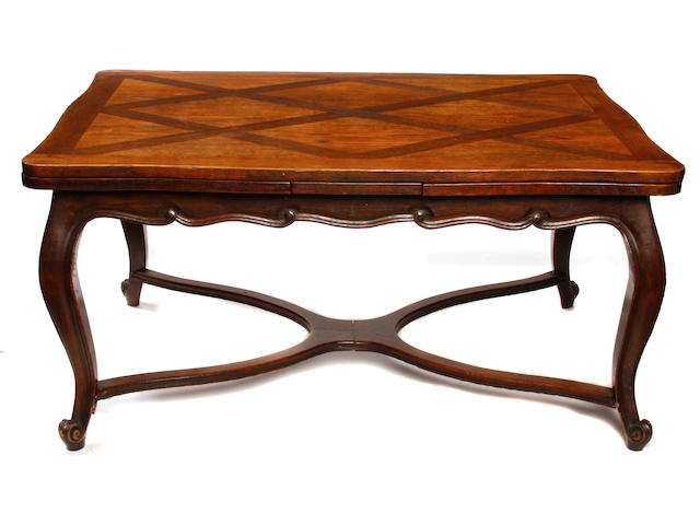 A Louis XV Provincial style oak extension dining table