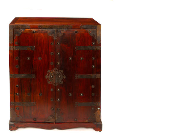 A Chinese brass mounted rosewood side cupboard