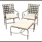 A large suite of patinated metal garden furniture