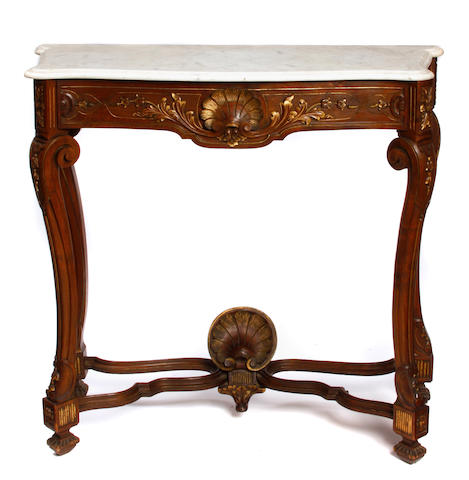 A Rococo style parcel gilt mahogany and marble console