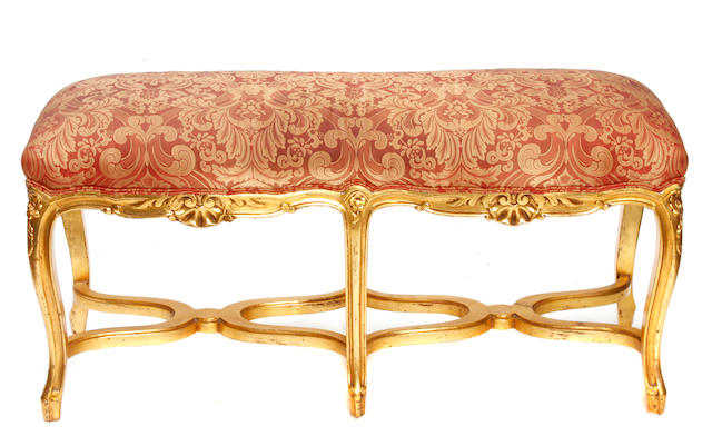 A Louis XV style giltwood window bench