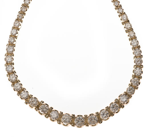A diamond and 14k white gold riviere necklace