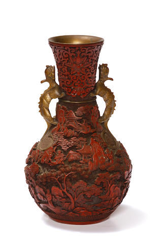 A carved cinnabar lacquer bronze vase Early 20th century