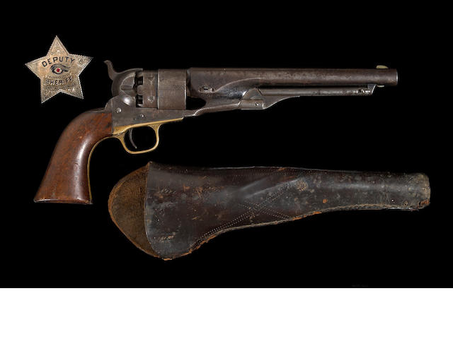A Colt Model 1860 Army percussion revolver with period holster and associated deputy sheriff's badge