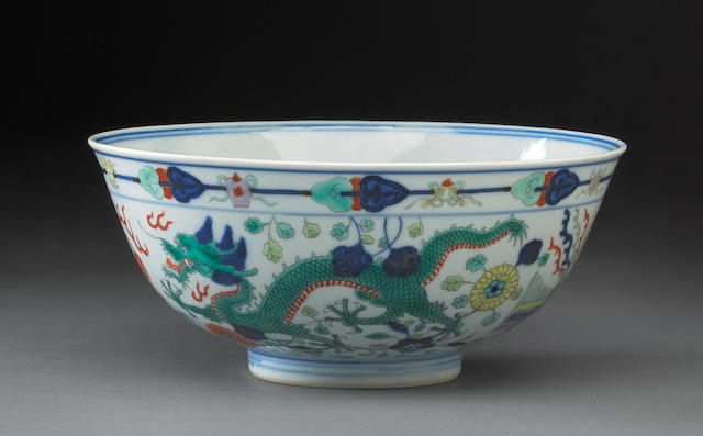 A wucai decorated porcelain dragon bowl six character Guangxu mark and period