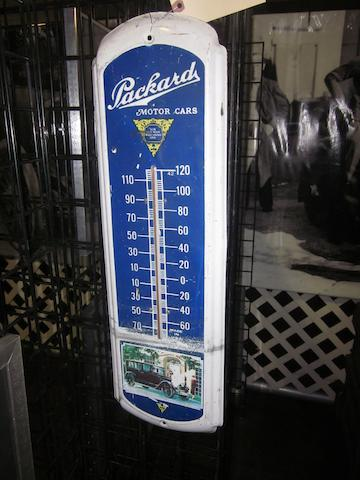 A large Packard motor cars thermometer pressed tin,