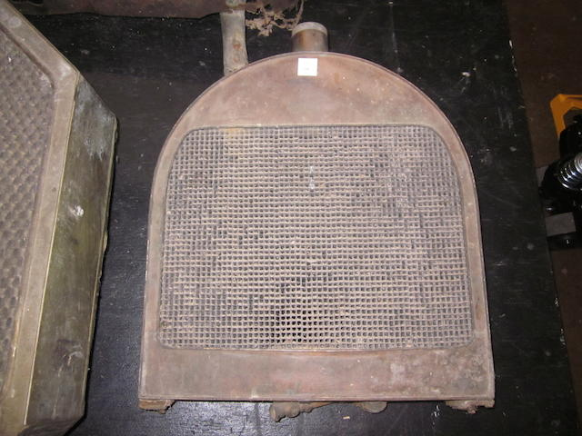 An original brass radiator for a Woods Mobillette.