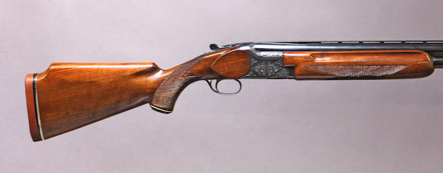 A 12 gauge over/under boxlock shotgun for Charles Daly by Miroku