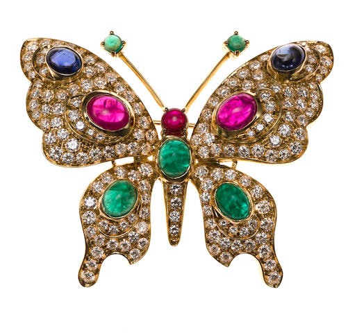 An emerald, ruby, sapphire and diamond butterfly pendant/brooch