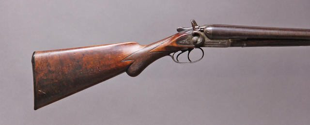 A 12 gauge double barrel coach gun by Manhattan Arms Company