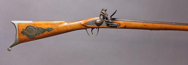 An unmarked reproduction flintlock rifle
