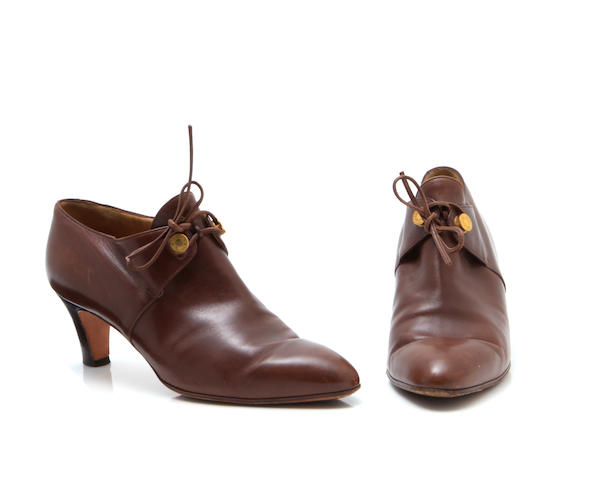 A pair of Hermès brown leather ankle boots