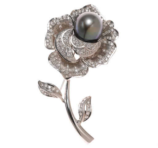 A colored South Sea cultured pearl and diamond flower brooch