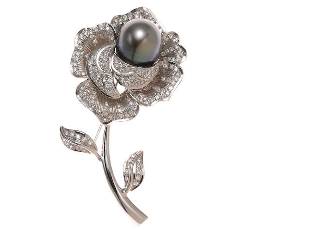 A Tahitian cultured pearl, diamond, and 14k white gold flower brooch