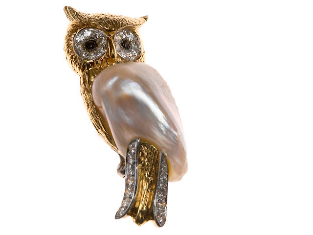 A wing pearl, diamond, platinum and 18 karat gold owl brooch, Ruser With black star sapphire set eyes.