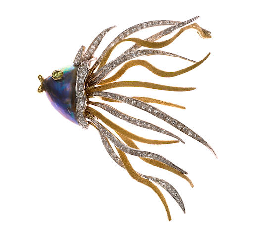 An 18 karat two tone gold, round brilliant and single cut diamond and abalone shell 'fish' brooch, Braun With colored diamond eyes. (nature of colored diamonds not determined)
