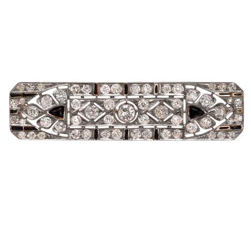 An art deco diamond and black onyx brooch,
