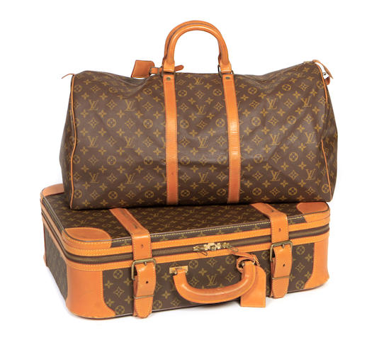 A Louis Vuitton soft sided suitcase and keepall duffle bag