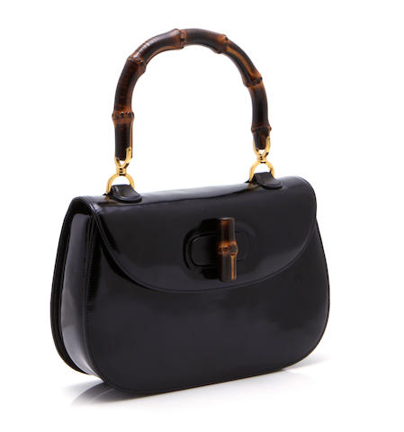 A Gucci black patent leather handbag