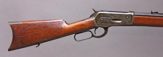 A Winchester Model 1886 lever action rifle