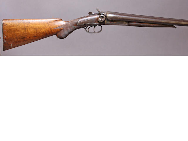 A 12 gauge Belgian double barrel hammer shotgun