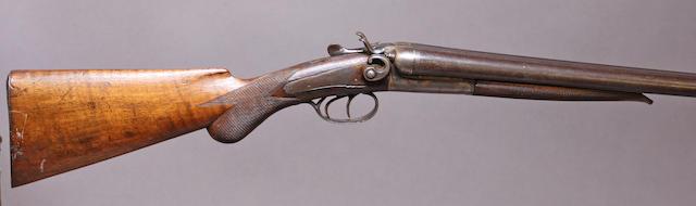 A 12 gauge Belgian double barrel hammer shotgun